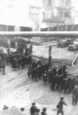 Deportation of Jews from the Warsaw ghetto during the uprising. This photo was taken secretly from a building adjacent to the ghetto by a Polish member of the resistance. Warsaw, Poland, April 1943.
