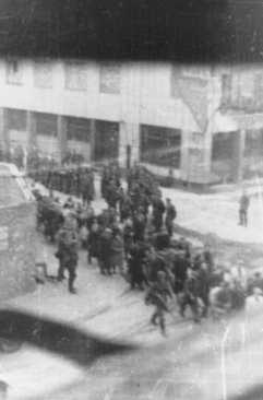 Deportation of Jews from the Warsaw ghetto during the uprising. The photograph was taken from a building opposite the ghetto by a member of the resistance. Warsaw, Poland, April 20, 1943.