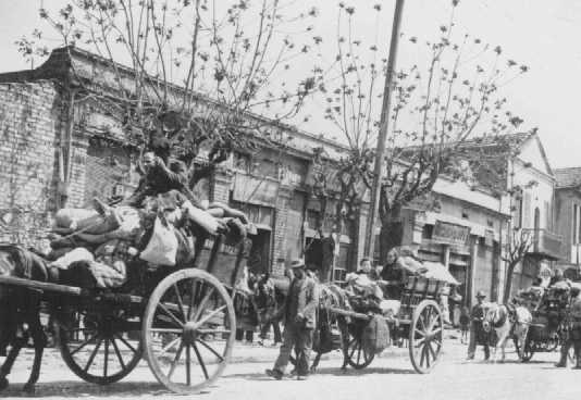 Greek Jews from the provinces move into a designated ghetto area. Salonika, Greece, between November 1942 and March 1943.