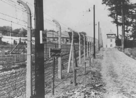 View of a guard tower and fence at the Buchenwald concentration camp. Germany, wartime.
