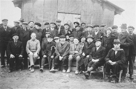 A group of  foreign-born Jews poses for a photo in Gurs, a French internment camp in southwestern France. Gurs, France, 1941.