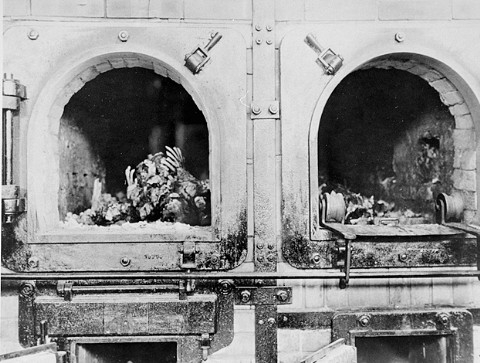 The charred remains of former prisoners in two crematoria ovens in the newly liberated Buchenwald concentration camp. Buchenwald, Germany, April 14, 1945.