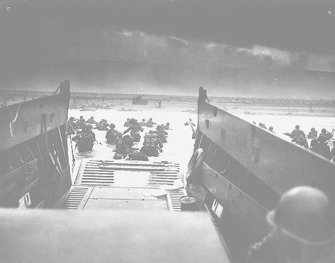 US troops wade ashore at Normandy on D-Day, the beginning of the Allied invasion of France to establish a second front against German forces in Europe. Normandy, France, June 6, 1944.