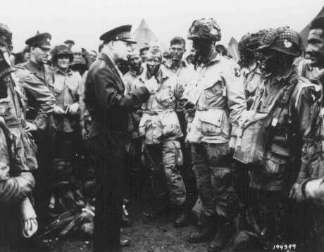 General Dwight D. Eisenhower visits with paratroopers of the 101st Airborne Division just hours before their jump into German-occupied France. June 5, 1944.