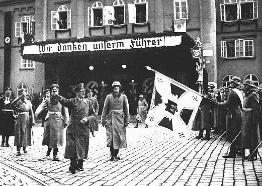 "Hitler in Brno (Bruenn) shortly after German troops occupied Czechoslovakia. The sign reads, ""We thank our Fuehrer."" Brno, Czechoslovakia, March 17, 1939."