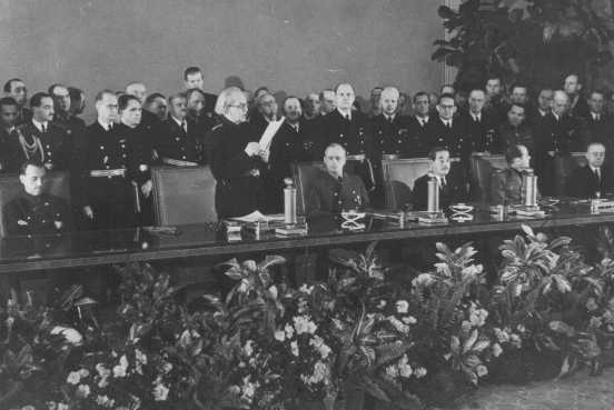 Slovak prime minister Vojtech Tuka (front row, standing) announces Slovakia's entry into the Axis alliance (initially Germany, Italy, and Japan; also joined by Hungary, Romania, and Bulgaria).  Berlin, Germany, November 1940.