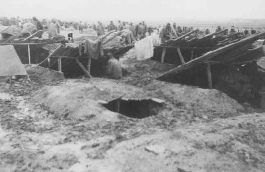 Dugouts, which served as living quarters for prisoners in Stalag 319—a Nazi-built camp for Soviet prisoners of war. Chelm, Poland, between 1941 and 1944.