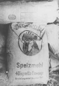 "Sack of wood flour (finely powdered wood or sawdust) used to make substitute bread. The official ration of this ""bread"" for Soviet prisoners of war was less than 5 ounces a day.  Deblin, Poland, 1942 or 1943."