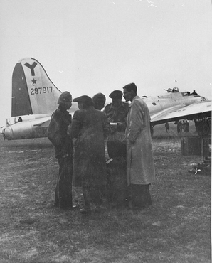 Haviva Reik and other parachutists from Palestine, under British command, sent to Slovakia to aid Jews during the Slovak national uprising. Hayim Hermesh (left), Haviva Reik (second from left),  Rafi Reiss (behind Reik), Abba Berdichev (second from the right), and Zvi Ben-Yaakov (right), on the Tri Duby airfield before being sent to Slovakia. Czechoslovakia, September 1944.