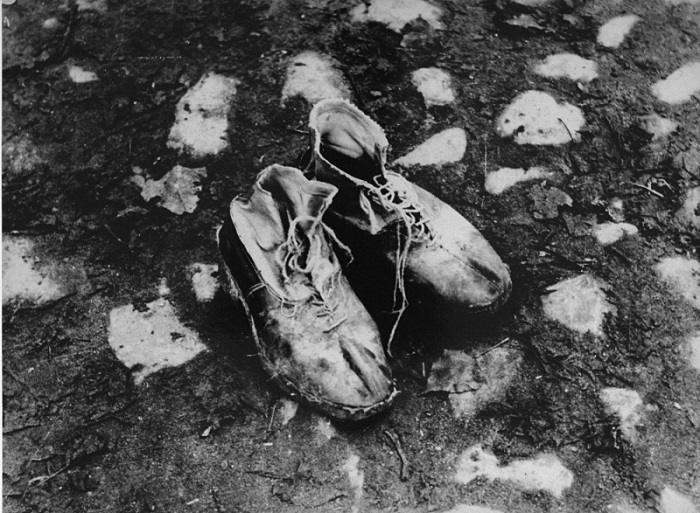 "A pair of shoes left behind after a deportation action in the Kovno ghetto. Photographer George Kadish captioned the photo ""The body is gone."" Kovno, Lithuania, circa 1943."