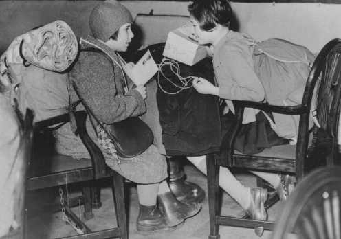 Two Austrian refugee children, part of a group of predominantly Jewish refugee children on a Children's Transport (Kindertransport), upon their arrival in Great Britain. Harwich, Great Britain, December 12, 1938.