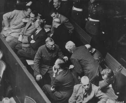 The defendants' box at the Nuremberg trial. Hermann Göring is seated at the far left of the first row. Nuremberg, Germany, 1945-1946.
