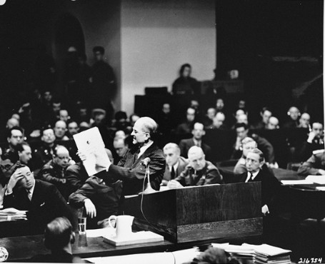 In the International Military Tribunal courtroom, executive trial counsel Colonel Robert G. Storey presents evidence of Nazi intentions to launch an aggressive war.