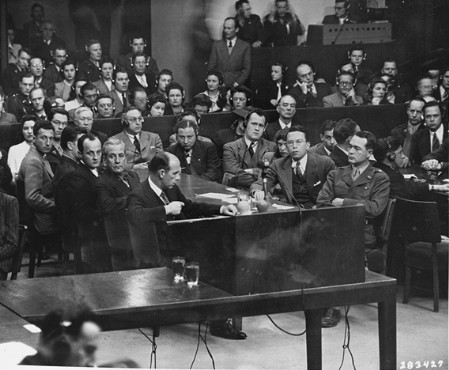 The prosecution team on the day the court announced its findings at the Milch Trial. Seated at the right is US Brigadier General Telford Taylor, chief of counsel. Across from him sits Clark Denny, chief trial counsel. April 16, 1947.