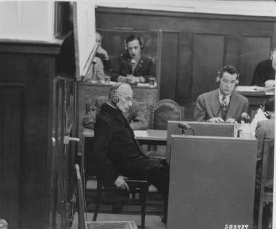 Priest Benedict Wein gives testimony as a witness for the prosecution during the Justice Case. April 28, 1947.