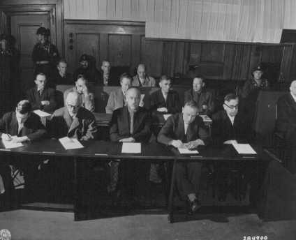 The I. G. Farben defendants hear the indictments against them before the start of the trial. May 5, 1947.