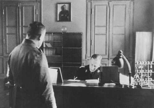 SS General Reinhard Heydrich in his office during his tenure as Bavarian police chief. Munich, Germany, April 11, 1934.