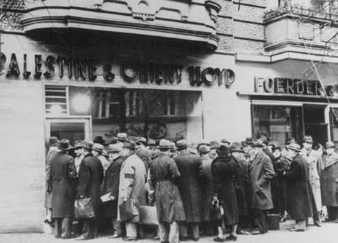 German Jews try to emigrate to Palestine; long lines in front of the Palestine and Orient Travel Agency. Berlin, Germany, January 22, 1939.