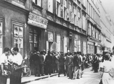Jews wait in line at the Margarethen police station for exit visas after Germany's annexation of Austria (the Anschluss). Vienna, Austria, March 1938.