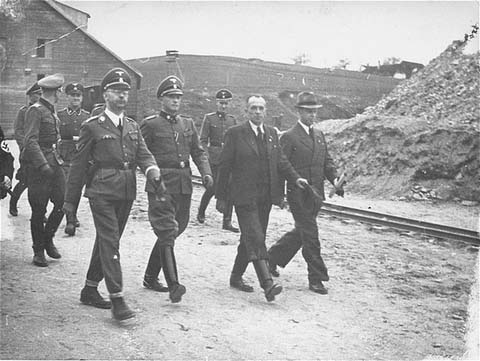 SS chief Heinrich Himmler (front row, left) and Mauthausen commandant Franz Ziereis (second from left) inspect the Mauthausen concentration camp. Austria, April 27, 1941.
