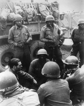 Members of the 12th Armored Division, which included African American platoons, await their orders. Germany, April 1945.