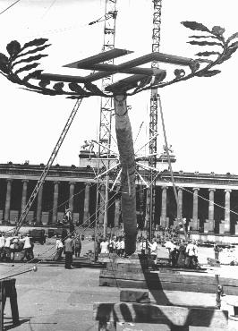 A  Maypole topped with a swastika is raised for a May Day parade in the Lustgarten in Berlin. The May holiday became an important celebration in the Nazi calendar. Germany, April 26, 1939.