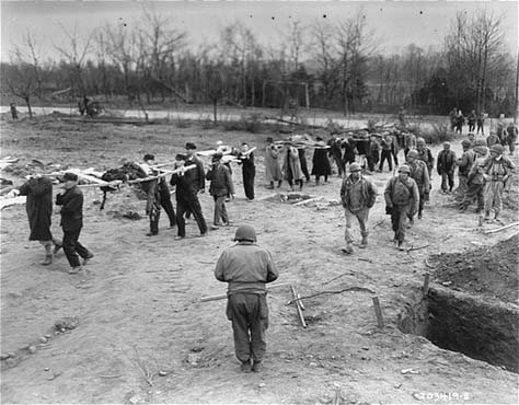 Under the supervision of the US First Army, German civilians from Nordhausen carry victims of the Dora-Mittelbau concentration camp to mass graves. Germany, April 14, 1945.