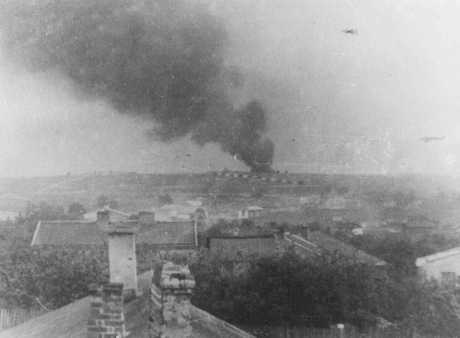 View of Majdanek extermination camp from a nearby village. The smoke could be from the burning of corpses. Poland, October 1943.