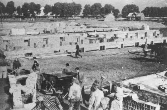 Prisoners at forced labor building an extension to the camp. Auschwitz-Birkenau, Poland, 1942-1943.