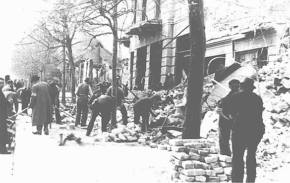 Jews forced to clear rubble from streets following the bombardment of Belgrade. Belgrade, Yugoslavia, 1941.