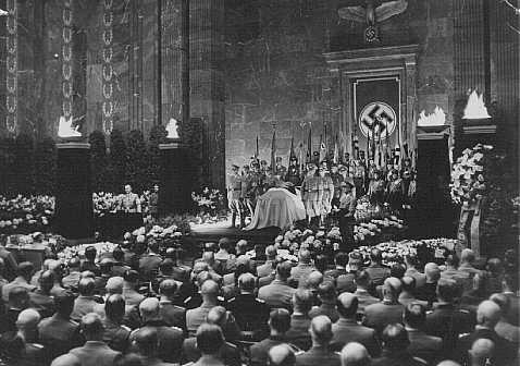 State funeral for Nazi district leader Carl Roever. Alfred Rosenberg delivers the funeral oration. Berlin, Germany, May 22, 1942.