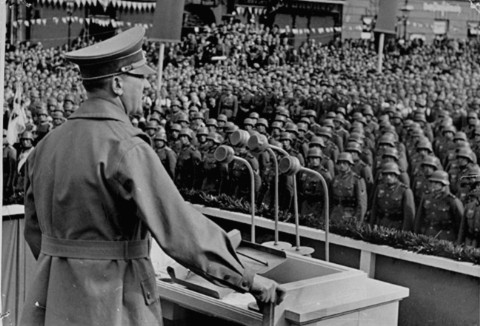 Hitler addresses German troops at the market square in Eger, during the German occupation of Czechoslovakia's Sudetenland region. October 3, 1938.