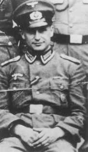 "SS Lieutenant Klaus Barbie in Nazi uniform. Barbie, responsible for atrocities against Jews and resistance activists in France, was known as the ""Butcher of Lyon."" Germany, date uncertain."
