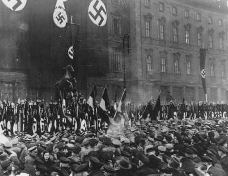 In Berlin, thousands of Party officials, Hitler Youth members, and Labor Service leaders take an oath of loyalty read by Rudolf Hess in Munich and broadcast across Germany. Berlin, Germany, February 25, 1934.