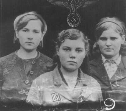 """Ostarbeiter"" (eastern workers) were mostly eastern European women brought to Germany for forced labor. They wore an ""OST"" identification patch (lower center of photograph) Germany, after 1942."