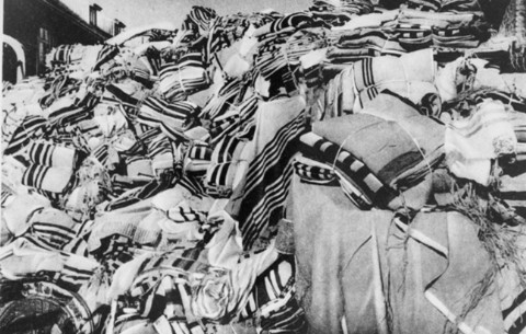 Piles of prayer shawls that belonged to Jewish victims, found after the liberation of the Auschwitz camp. Poland, after January 1945.