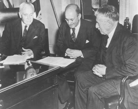 Photo taken in Secretary of State Cordell Hull's office on the occasion of the third meeting of the War Refugee Board. Hull is at the left, Secretary of the Treasury Henry Morgenthau, Jr., is in the center, and Secretary of War Henry L. Stimson is at the right. Washington, DC, United States, March 21, 1944.
