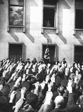 On the day of his appointment as German chancellor, Adolf Hitler greets a crowd of enthusiastic Germans from a window in the Chancellery building. Berlin, Germany, January 30, 1933.