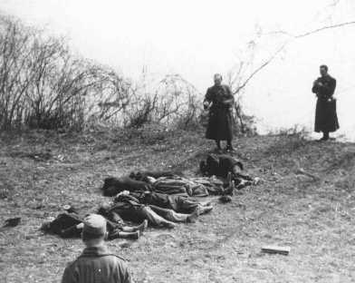 Arrow Cross Party members execute Jews along the banks of the Danube River. Budapest, Hungary, 1944.