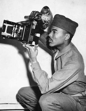 African Americans were among the liberators of the Buchenwald concentration camp. William Scott, seen here during training, was a military photographer and helped document Nazi crimes in the camp. Alabama, United States, March 1943.