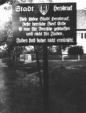"""A sign outside a town in northern Bavaria warns: """"City of Hersbruck. This lovely city of Hersbruck, this glorious spot of earth, was created only for Germans and not for Jews. Jews are therefore not welcome."""" Hersbruck, Germany, May 4, 1935."""