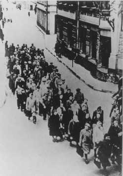"Jews from the Riga ghetto on the ""Aryan"" side of Riga. Some groups of Jews were taken outside the ghetto for forced labor. Riga, Latvia, between 1941 and 1943."