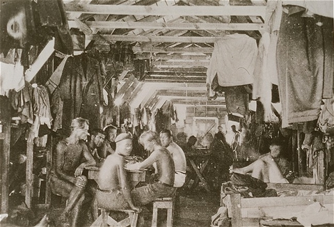 Crowded living conditions: prisoners inside a barracks at Gurs detention camp. France, probably 1940.