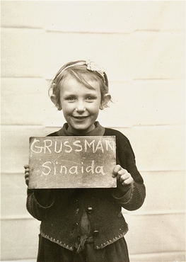 A girl in the Kloster Indersdorf children's center who was photographed in an attempt to help locate surviving relatives. Such photographs of both Jewish and non-Jewish children were published in newspapers to facilitate the reunification of families. Germany, after May 1945.