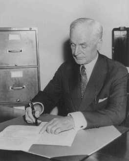 Four days after the outbreak of World War II, Secretary of State Cordell Hull signs the Neutrality Law (first signed by President Franklin D. Roosevelt) at the State Department. Washington, DC, United States, September 5, 1939.