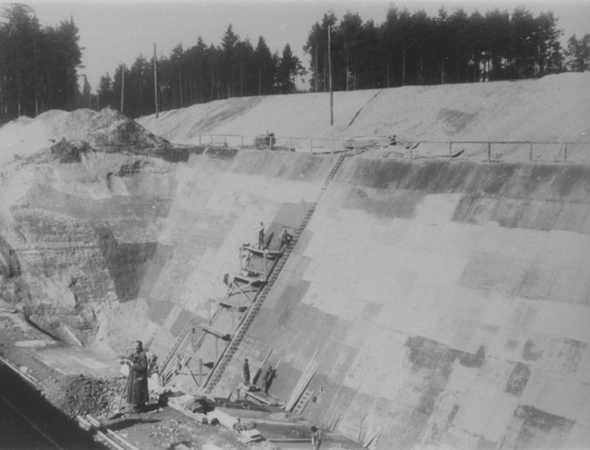 Forced laborers build the south wall of the foundation of the new Dachau satellite camp of Weingut I in Mühldorf . Germany, 1944.