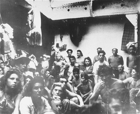 "Refugees, previously passengers on the ship ""Exodus 1947,"" crowded on a British deportation ship. Port-de-Bouc harbor, France, July 28, 1947."