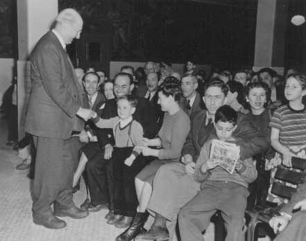Henry Morgenthau, Jr., treasury secretary in the Roosevelt administration and later chairman of the United Jewish Appeal, greets Jewish refugees en route from Shanghai to Israel. New York, United States, March 2, 1949.