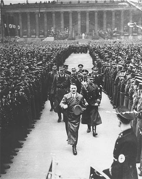 Hitler reviews 35,000 SA troops celebrating the third anniversary of his assumption of power. Berlin, Germany, February 20, 1936.