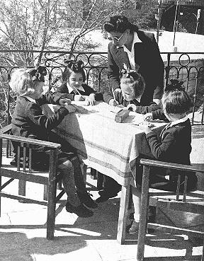 "Some of the Polish Jewish refugee children known as the ""Tehran Children"" with an instructor after their arrival in Palestine. Atlit, Palestine, 1943."